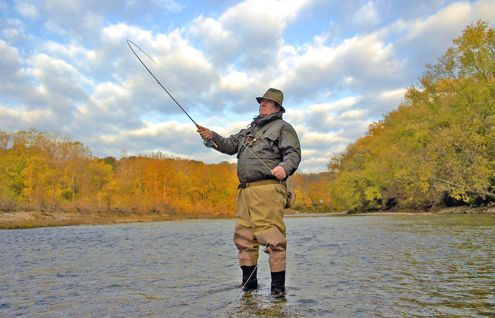 Former water conservationist Tim Guilfoile fishes in the Little Miami River.