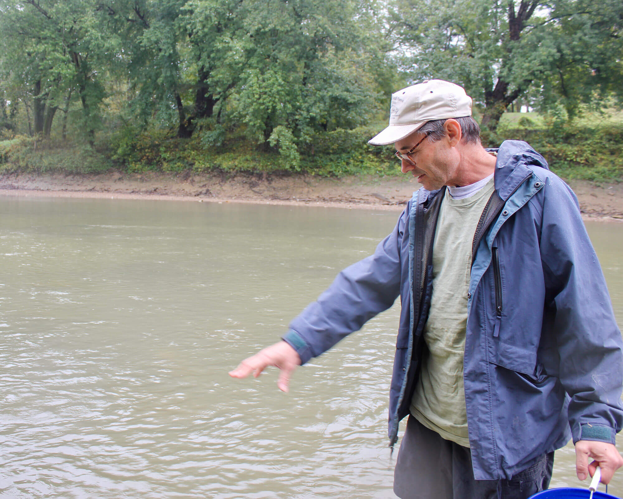 U.S. Forest Service Fisheries Research Biologist Wendell R. Haag talks about the freshwater mussels that live in this stretch of the Licking River near Butler, Kentucky. (Photo by Carrie Blackmore Smith/PublicSource)